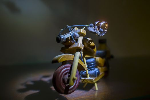 Wedding rings on a toy wooden motorcycle.Wedding biker. Wedding rings. Wedding day.