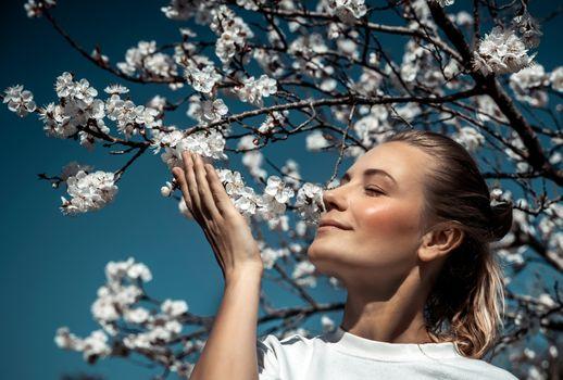 Enjoying aroma of blooming tree