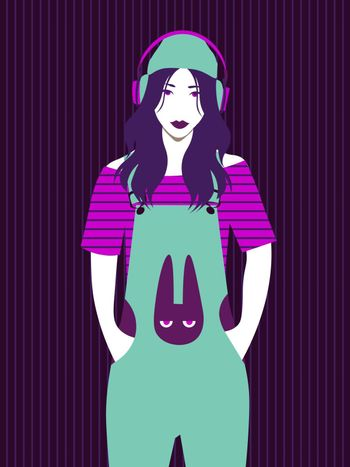 cute bright girl in overalls with bunny print and hat listening to music in big headphones on striped background