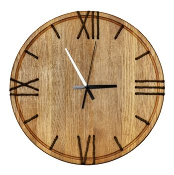 Beautiful wooden wall clock made of light oak wood and roman numerals on the dial made of natural twine on white background isolated.