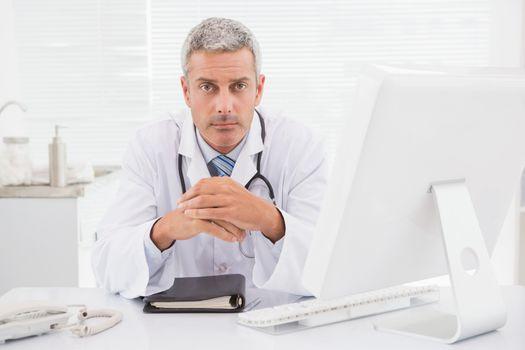 Unsmiling doctor looking at camera