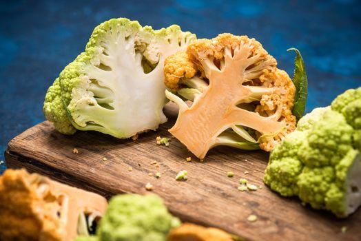 Market Fresh Organic Green and Yellow Cauliflowers Cabbage. Plant Based Vegan Diet.