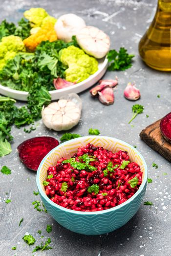 Cooking Vegetarian Plant Based Food. Buckwheat Groats with Beetroot and Parsley.