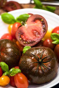 Vibrant Fresh Tomatoes. Vegan Food Market Fresh. Colorful Tomatoes on Conrete Background.