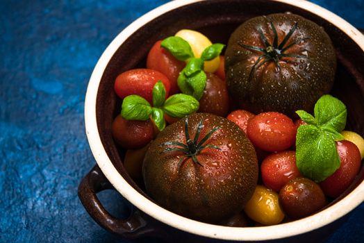 Organic Fresh Tomatoes in Ceramic Pan. Food Background.