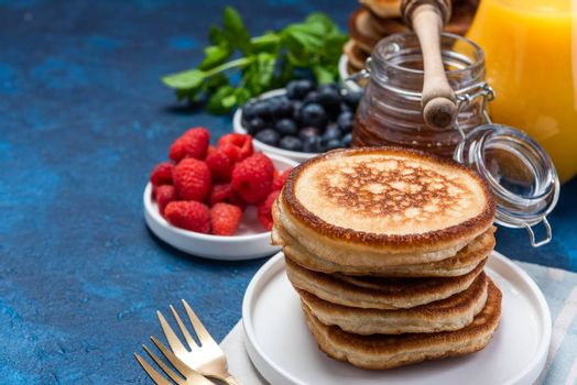 Fluffy American Pancakes with Fresh Fruits and Honey.