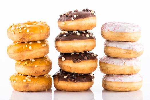 Donuts or Doughnuts Tower on White Background. Donut Stack Pile Food Background.