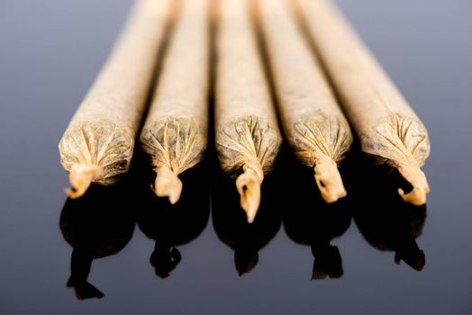 Medical Cannabis Marijuana Joints on Black Background, Close Up View.
