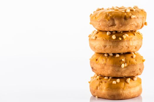 Salted Caramel Donut or Doughnuts on White Reflective Background with Copy Space.
