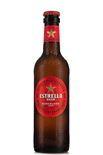TARNOW, POLAND - FEBRUARY 01, 2020: Bottle of Cold Estrella  Beer. Spanish Estrella Brand Are Increasingly Popular .