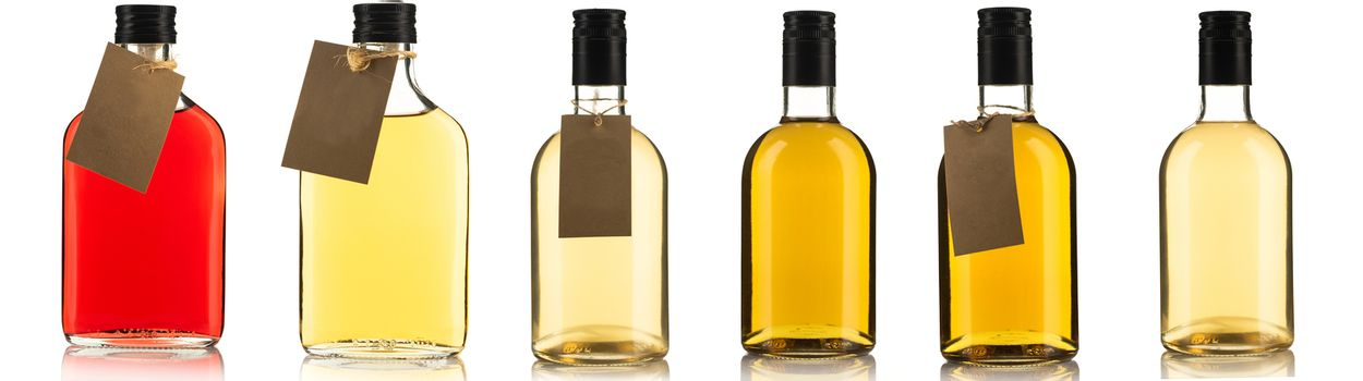 Assortment of Bottles with Herbal Tincture or Alcohol Liqour Isolated On White Background Banner.