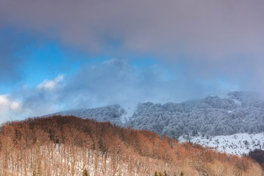 Dramatic and Moody Image of Weather in Mountains at Winter Time.