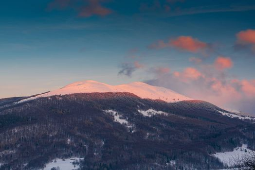 Sunrise over Polonyna Wetlinska and Carynska in Carpathian Mountains. Bieszczady, Poland at Winter Season.