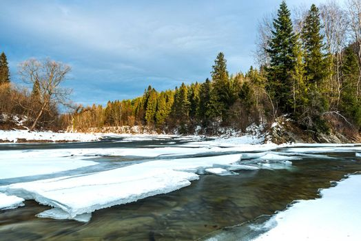 Ice over River San in Bieszczady Mountains at Winter Season.