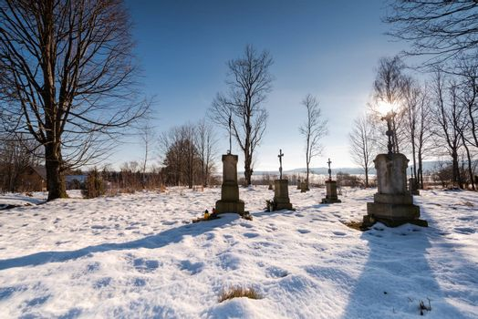 Small Cemetary in Bieszczady Village Bystre at Winter Time Covered in Snow.
