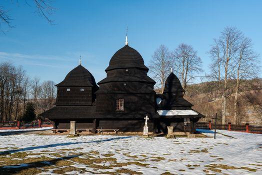 Exterior of Rownia Wooden Orthodox Church.  Bieszczady Architecture in Winter. Carpathia Region in Poland.