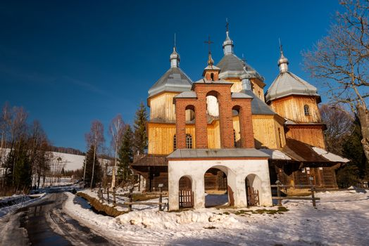 Wooden Orthodox Church in Bystre. Carpathian Mountains and Bieszczady Architecture in Winter.