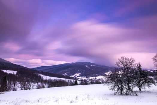 Pastel Pink Sunrise over Bieszczady Mountains in Poland. Long Exposure Photo. Panoramic View.