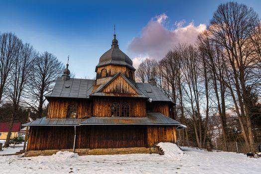 Exterior of St. Nicholas Orthodox Church in Chmiel.  Bieszczady Architecture in Winter. Carpathia Region in Poland.