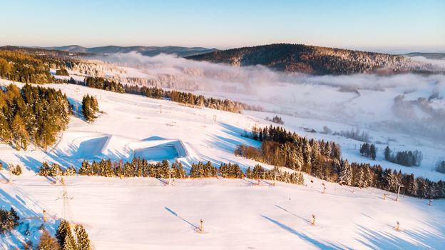 Slotwina Ski Lift near Krynica in Poland at Sunrise in Winter Season. Aerial Drone View.