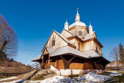Exterior of Hoszow Wooden Orthodox Church.  Bieszczady Architecture in Winter. Carpathia Region in Poland.