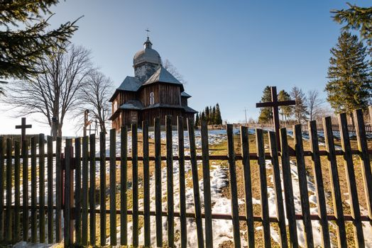 Wooden Orthodox Church in Hoszowczyk. Carpathian Mountains and Bieszczady Architecture in Winter.