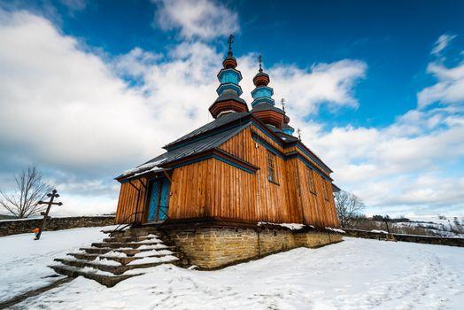 Exterior of Komancza Wooden Orthodox Church.  Bieszczady Architecture in Winter. Carpathia Region in Poland.