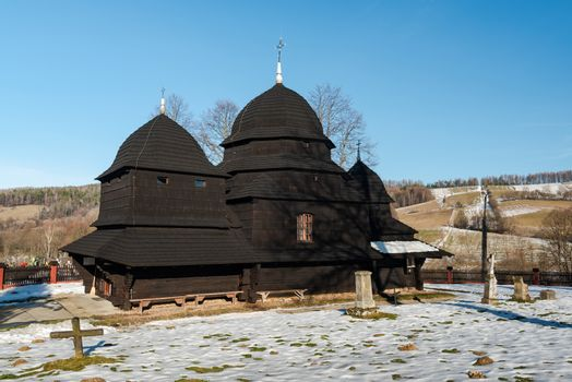 Wooden Orthodox Church in Rownia. Carpathian Mountains and Bieszczady Architecture in Winter.