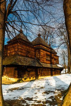 Exterior of Smolnik Wooden Orthodox Church.  Bieszczady Architecture in Winter. Carpathia Region in Poland.