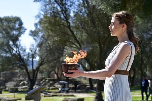 Olympia, Greece -  March 12, 2020: Olympic Flame handover ceremony for the Tokyo 2020 Summer Olympic Games at the Ancient Olympia site, birthplace of the ancient Olympics in southern Greece.