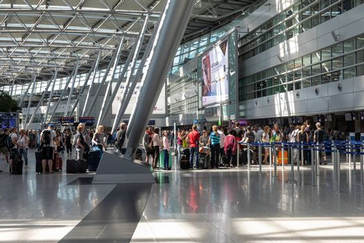 Dusseldorf, Germany - July 3, 2018: Hall of a departure of the airport Dusseldorf International. Dusseldorf Airport located approximately 7 kilometres north of downtown Dusseldorf