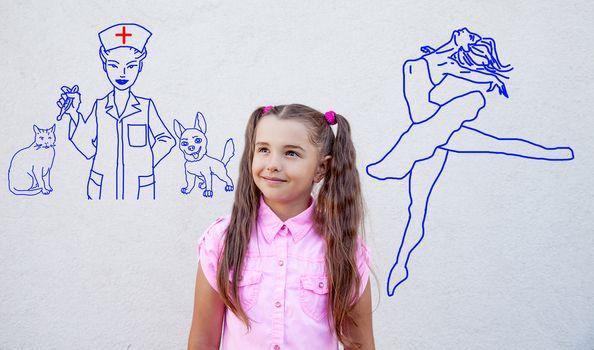little girl dreams of becoming a ballet dancer or veterinarian