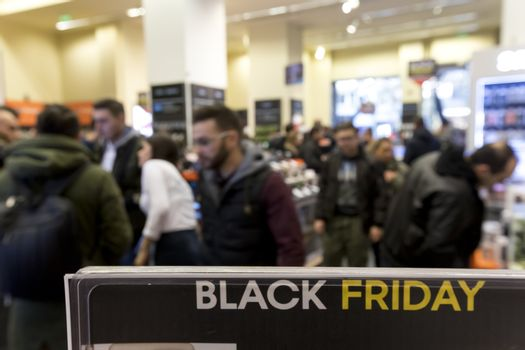 Thessaloniki, Greece - November 24, 2017. People shop inside a department store during Black Friday shopping deals, at the northern Greek city of Thessaloniki.