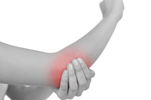 Close up of young woman with a sore elbow