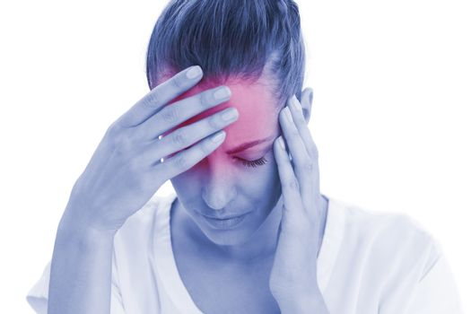 Woman having a headache with her head in her hands