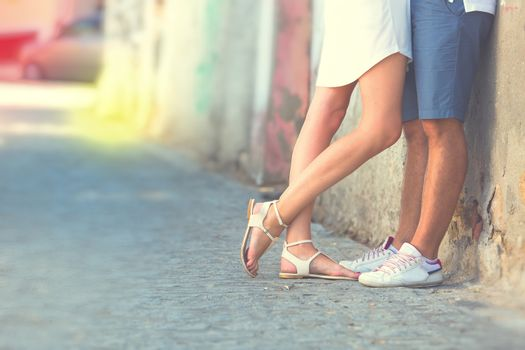 Young couple kissing outdoor. Male and female legs. Vintage