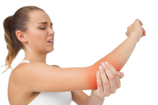 Suffering young woman touching her sore elbow