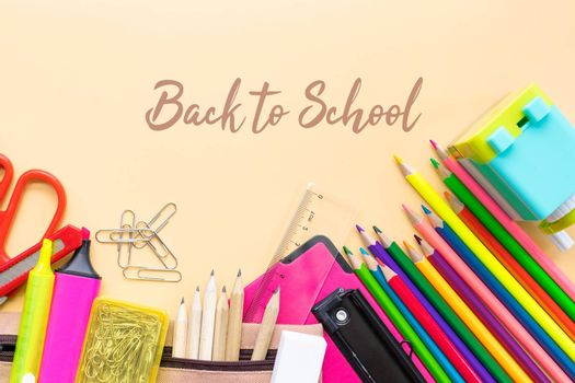 Welcome back to school background, colorful color pencil and stationery bag on yellow backgrounds with copy space
