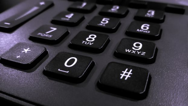 close up on the numbers on the keypad phone, fixed phone