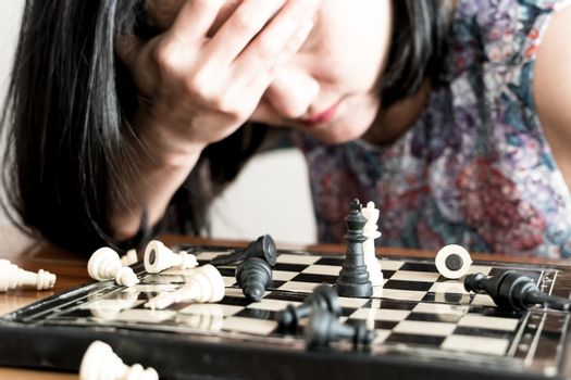 the loser women sad after  fighting the chess, committed, compet