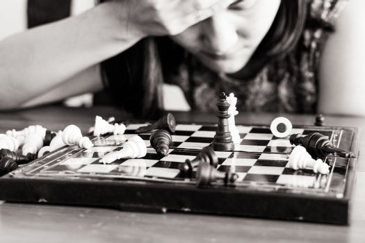 the loser women sad after  fighting the chess
