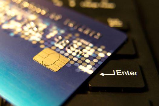 closeup credit card on black enter button, convenience shopping