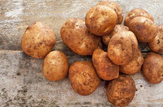 Pile of fresh whole farm potatoes