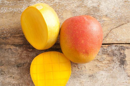 Ripe sliced and whole sweet tropical mango
