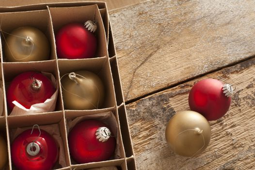 Boxed red and gold Christmas baubles