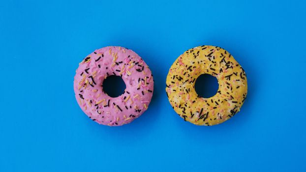 Two fashion round donuts. colorful minimalism concept.