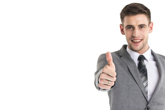 Smiling young businessman with thumb up isolated on white background