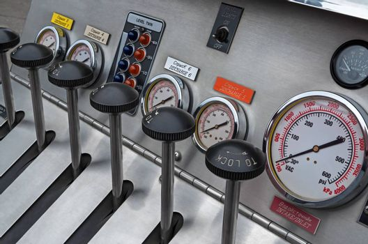 Instrument panel of a fire truck made of stainless steel and plastic.
