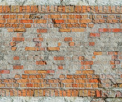 Brick wall of the old house of the 19th century restored after the bombing of the Second World War