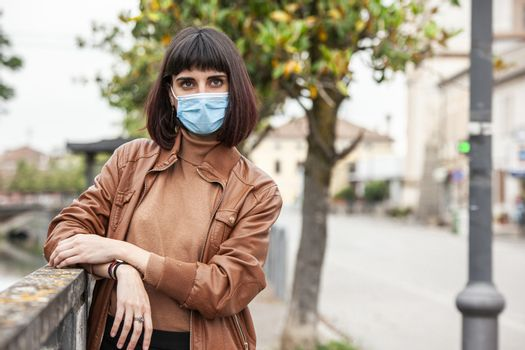 Portrait of a Girl with medical mask outdoor during covid quarantine in Italy
